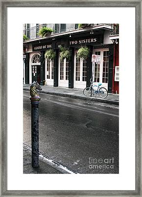 Across The Street Framed Print by John Rizzuto