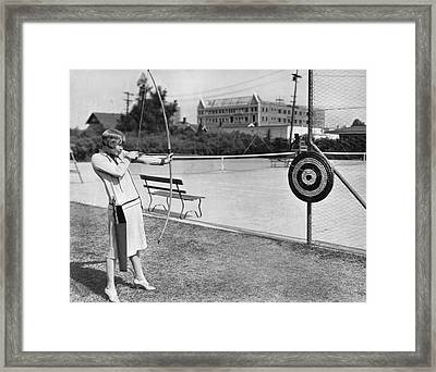 Actress Shooting An Arrow Framed Print by Underwood Archives