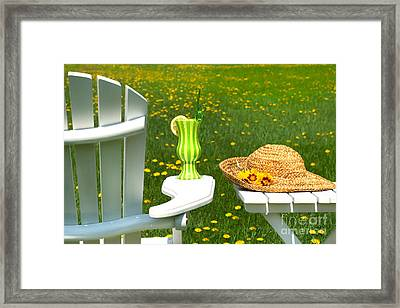 Adirondack Chair On The Grass  Framed Print