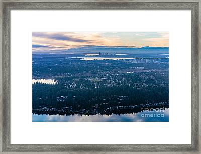 Aerial Seattle And Bellevue Skylines Across Lake Washington And Lake Sammamish Towards The Cascades Framed Print by Mike Reid