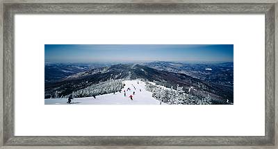 Aerial View Of A Group Of People Skiing Framed Print