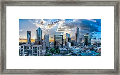 Aerial View Of Charlotte City Skyline At Sunset Framed Print by Alex Grichenko