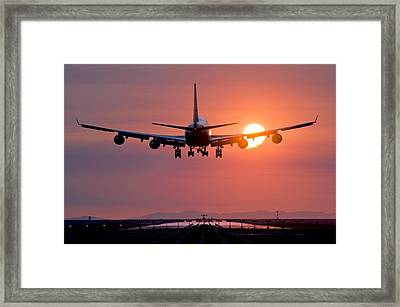 Aeroplane Landing At Sunset, Canada Framed Print by David Nunuk