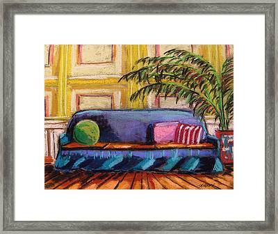 Against A Yellow Wall Framed Print by John Williams