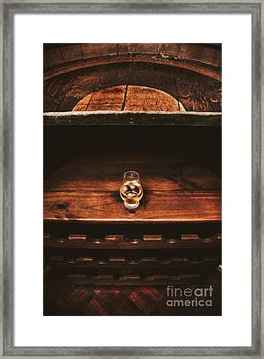Aged Glass Of Rum On Cellar Barrel Framed Print