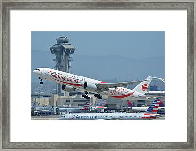 Framed Print featuring the photograph Air China Boeing 777-39ler B-2035 Smiling China Los Angeles International Airport May 3 2016 by Brian Lockett