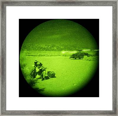 Air Crewmen Perform A Personnel Recovery Mission  Us Navy Framed Print