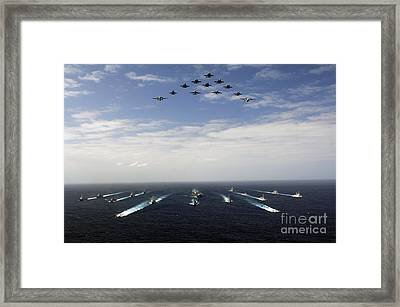 Aircraft Fly Over A Group Of U.s Framed Print