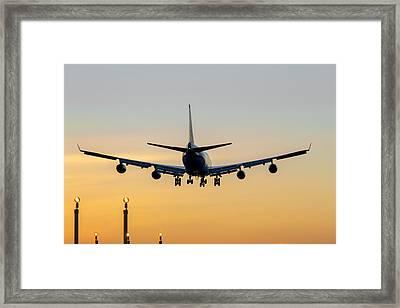 Aircraft Landing At Sunset Framed Print by Derek Beattie