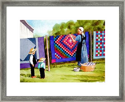 Airing The Quilts Framed Print by Faye Ziegler