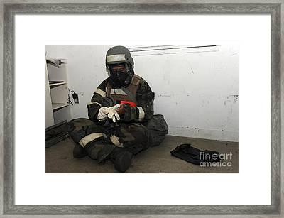 Airman Dons His Chemical Warfare Framed Print