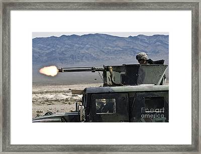 Airman Fires A .50 Caliber Heavy Framed Print by Stocktrek Images