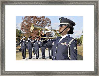 Airman Plays Taps During The Veterans Framed Print by Stocktrek Images