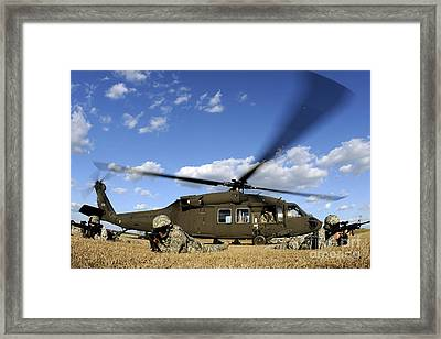 Airmen Provide Security In Front Framed Print