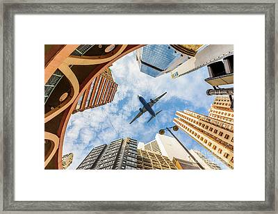 Airplane Above City Framed Print