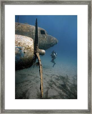 The Dakota Airplane Underwater Framed Print by Rico Besserdich