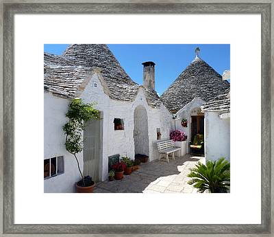 Alberobello Courtyard With Trulli Framed Print