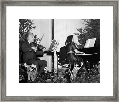 Albert Einstein Giving A Violin Recital Framed Print by Everett