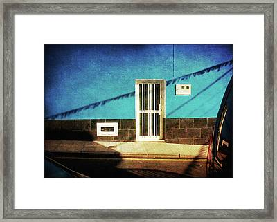 Framed Print featuring the photograph Alcala Blue Wall White Door by Anne Kotan
