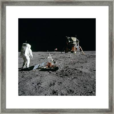 Aldrin Looks Back At Tranquility Base  Framed Print by Paul Fearn