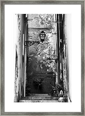 Alley Light Framed Print by John Rizzuto