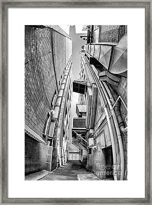 Alley Stacks Framed Print by Bryan Freeman