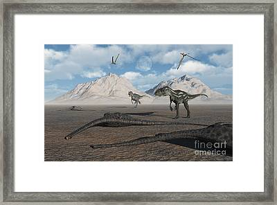 Allosaurus Dinosaurs Approach A Group Framed Print by Mark Stevenson