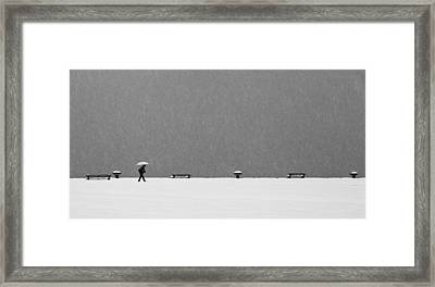 Alone In Snowstorm Framed Print by Eric Monvoisin
