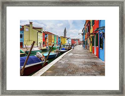 Along The Canal In Burano Island Framed Print