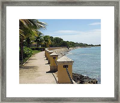 Along The Pier Framed Print