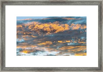 Clouds Of A Different Color Framed Print