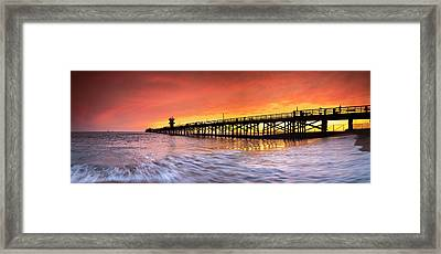 Amber Seal Beach Pier Framed Print by Sean Davey
