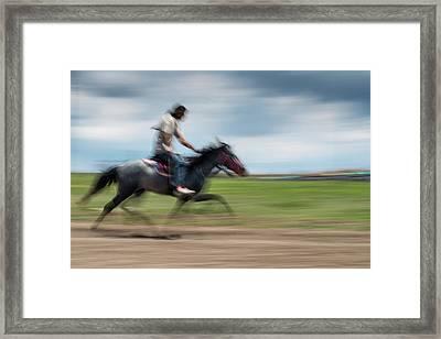 Ambling Race Framed Print by Okan YILMAZ