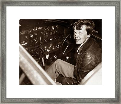 Amelia Earhart Sitting In Airplane Cockpit Framed Print by War Is Hell Store