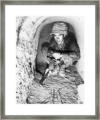 American Soldier Using A Knife To Probe Framed Print