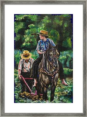 Amish Plowing Framed Print by Laurie Tietjen