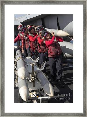 Ammunition Loaders Carry An Aim-120 Framed Print by Gert Kromhout