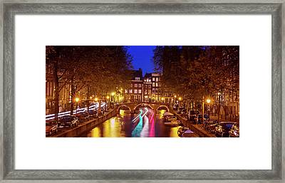 Framed Print featuring the photograph Amsterdam By Night by Barry O Carroll