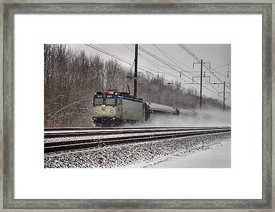 Amtrak In Snowstorm Framed Print