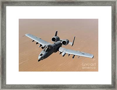 An A-10 Thunderbolt II Over The Skies Framed Print