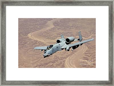 An A-10 Thunderbolt Soars Framed Print by Stocktrek Images