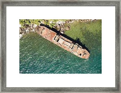 An Abandoned Cargo Ship On Nosy Mangabe Framed Print by Michael Fay