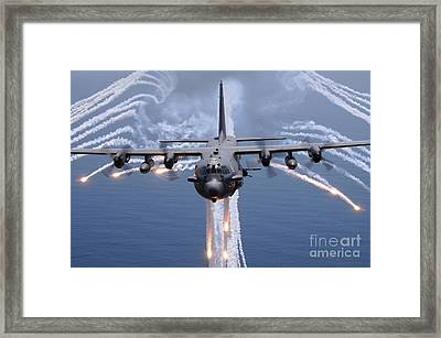An Ac-130h Gunship Aircraft Jettisons Framed Print