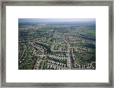 An Aerial View Of Urban Sprawl Framed Print by Joel Sartore