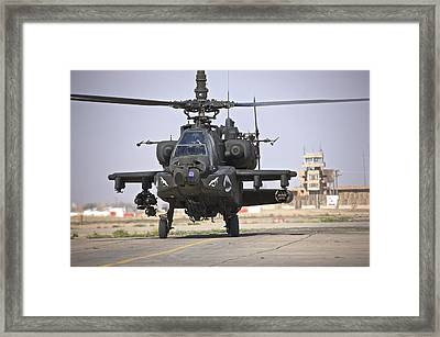 An Ah-64 Apache Helicopter Returns Framed Print by Terry Moore
