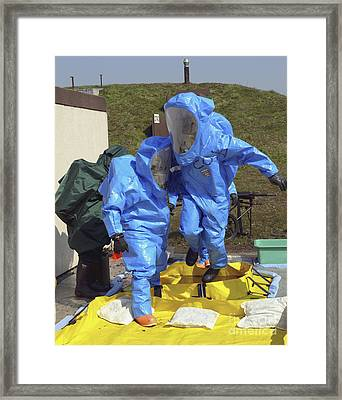 An Airman And A Soldier Jump Into A Tub Framed Print by Stocktrek Images