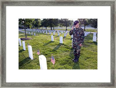 An Airman Renders Honors After Placing Framed Print
