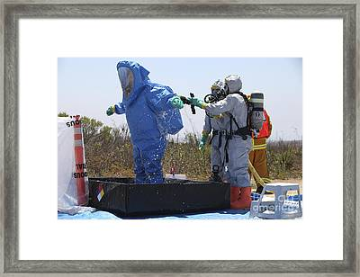 An Airman Stands In A Tub Of Cleaning Framed Print by Stocktrek Images