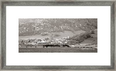 An Alpine Village  Framed Print by Olivier Le Queinec