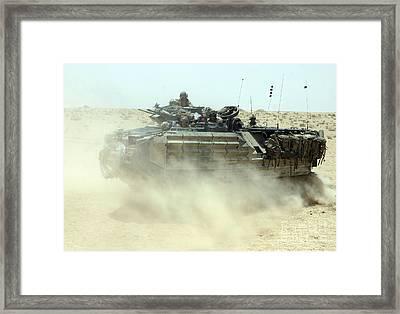 An Amphibious Assault Vehicle Kicks Framed Print by Stocktrek Images